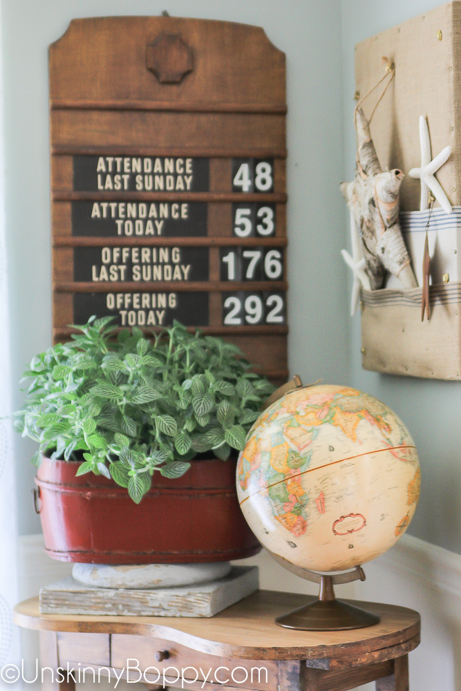 church attendance sign with globe