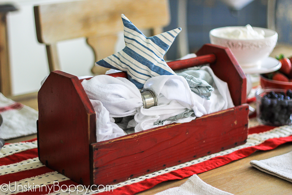 red tool box with white napkins and blue star ticking