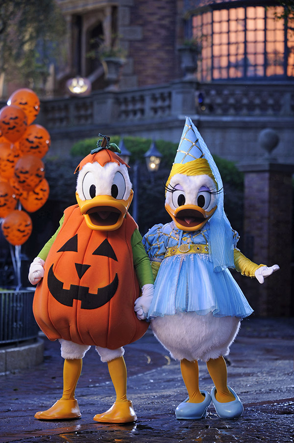 Donald Duck and Daisy dressed up for Mickey's not-so-spooky Halloween party at Disney World