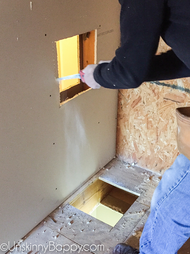 Cutting holes in wall and floor of attic to install a laundry chute