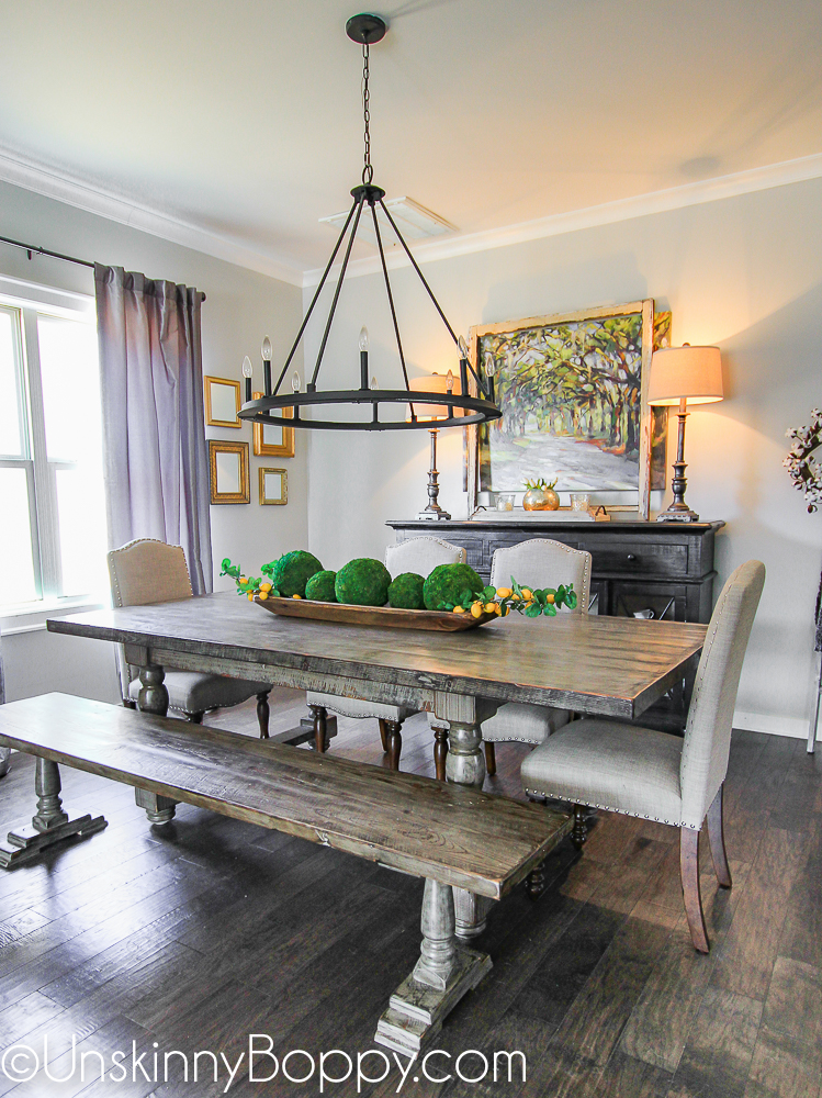 Farmhouse dining table with bench and circular light fixture