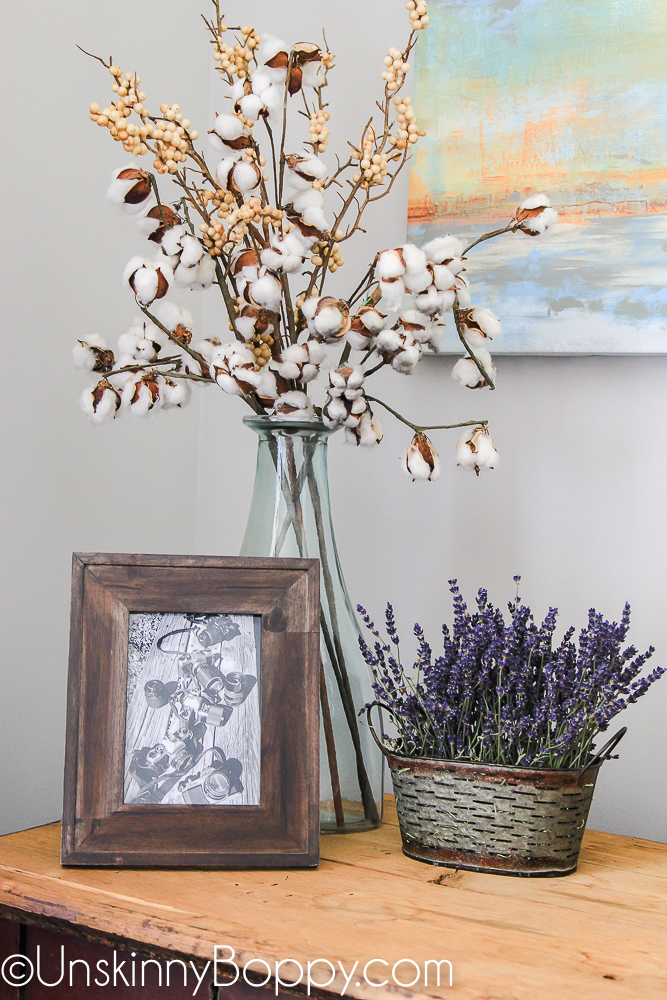 cotton stems and lavender in an olive bucket