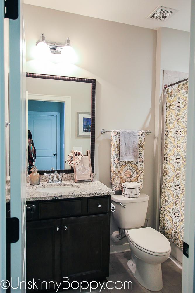 Bathroom decor with black vanity
