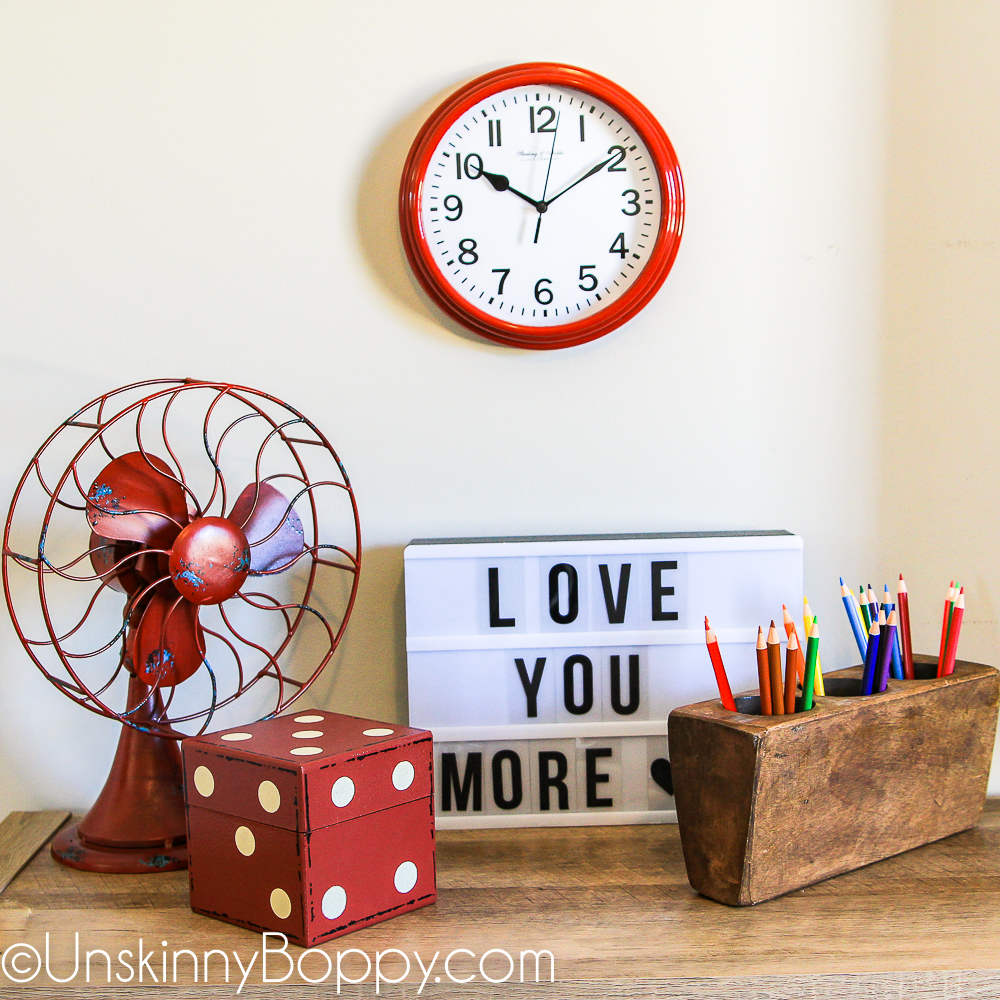 red clock and fan with sugar mold and letterbox