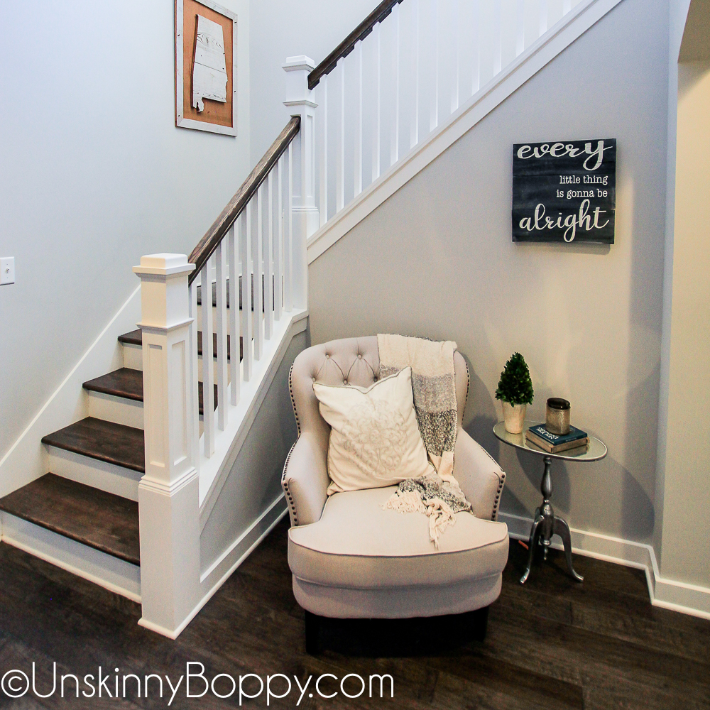 Staircase with cozy reading chair in the corner