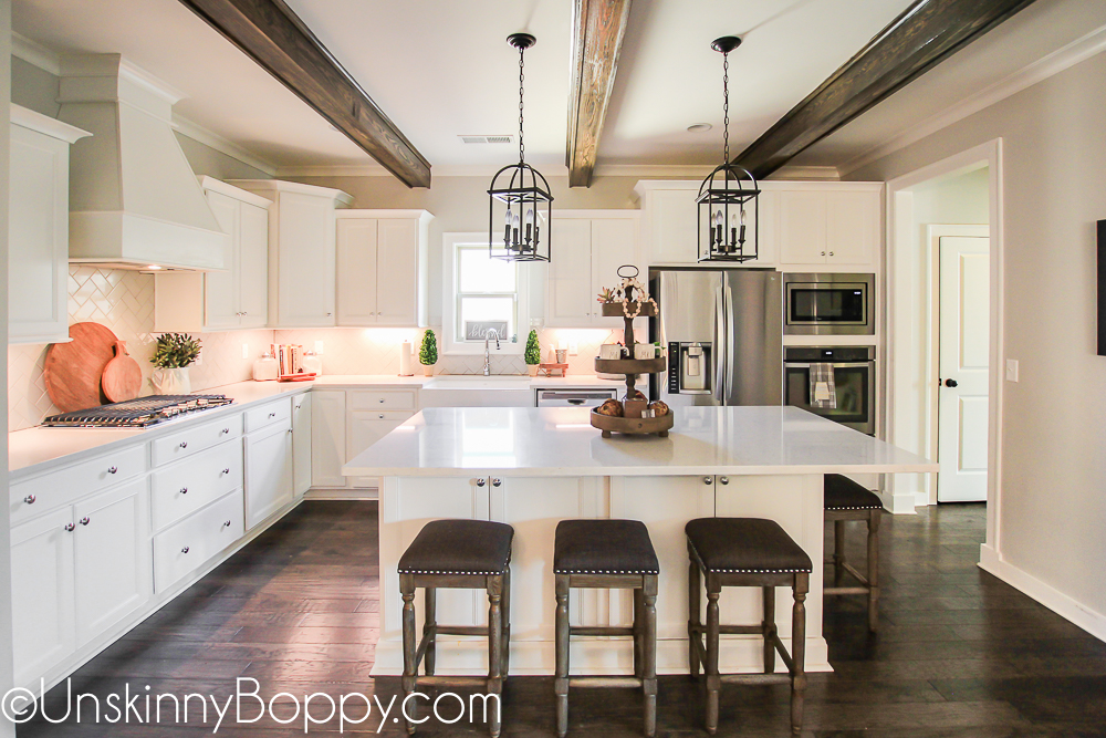 White kitchen with wooden beams