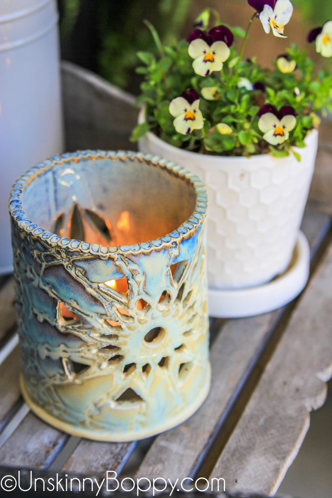 blue ceramic luminaria with viola flowers