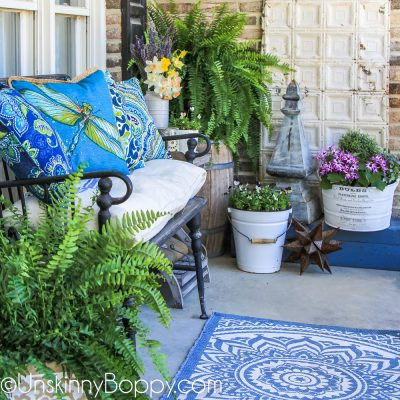 Narrow front porch decorated for summer