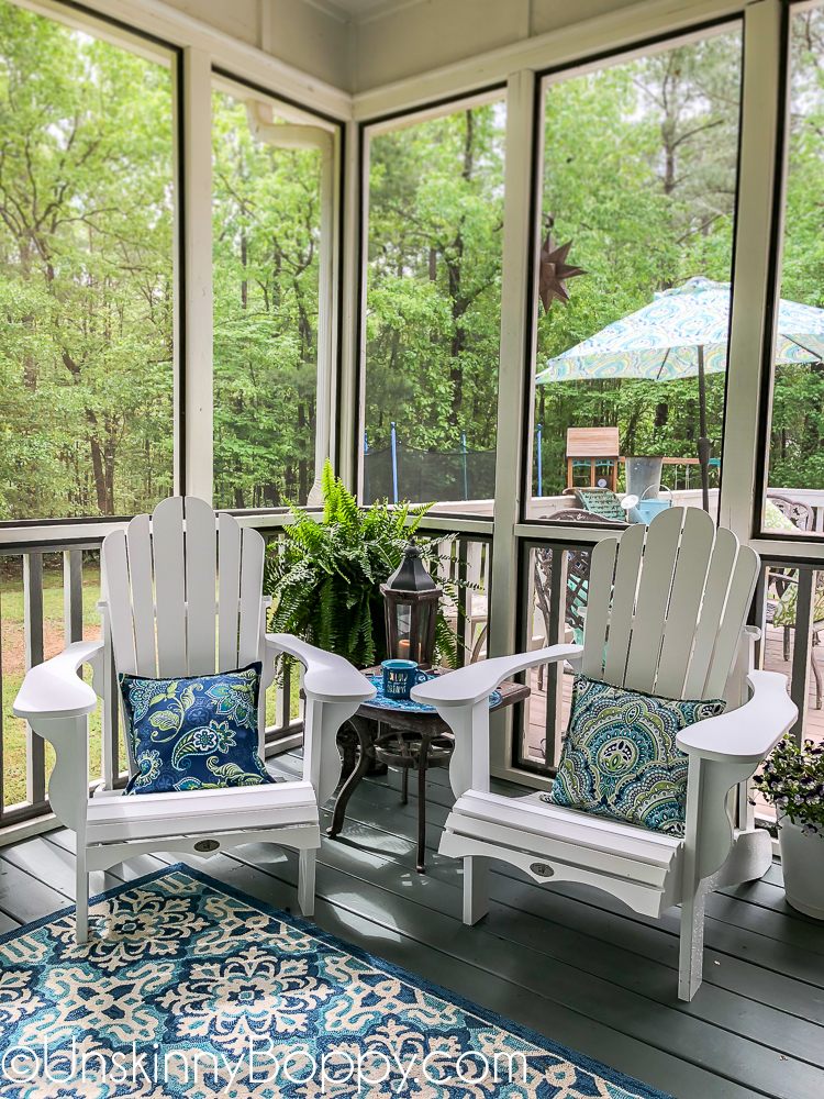 White adirondack chairs with blue and aqua rug