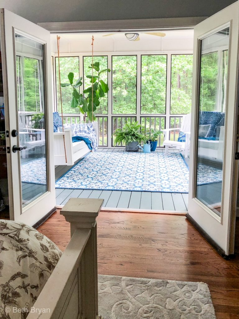 Screened in back porch off master bedroom creates an outdoor room.