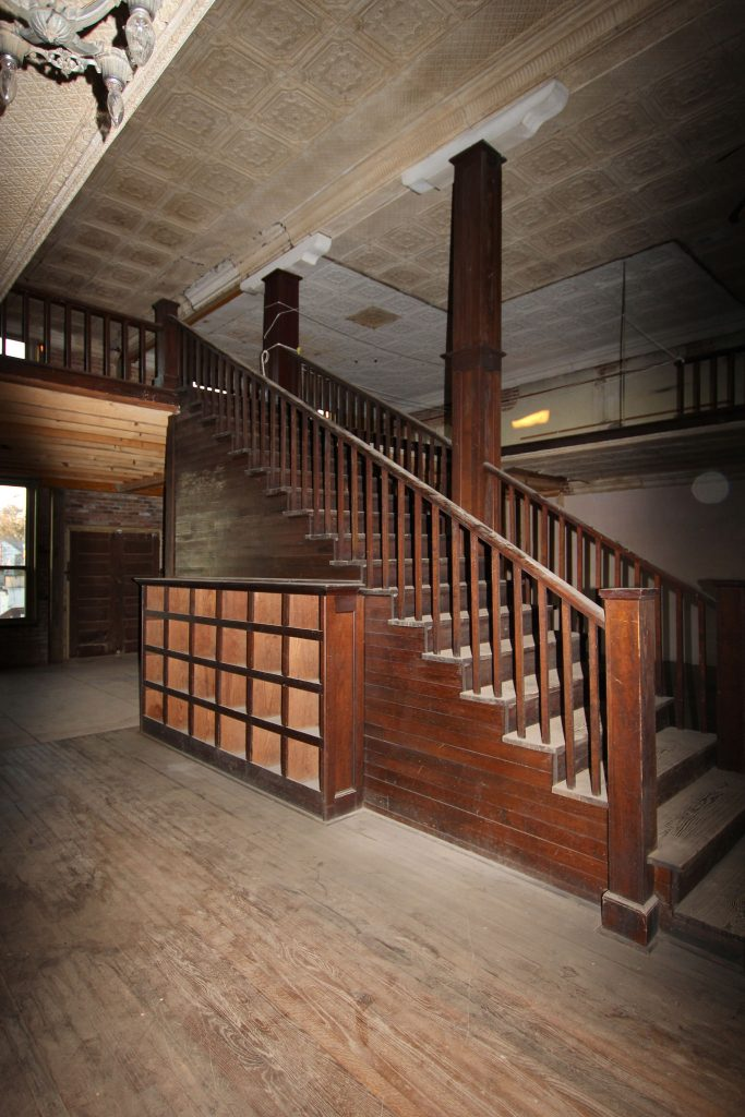 Staircase in a Turn-of-the-Century Mercantile Store in need of renovation