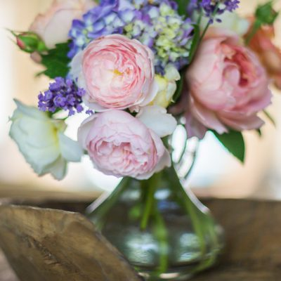 Cut flower arrangement of roses, hydrangea and lavender
