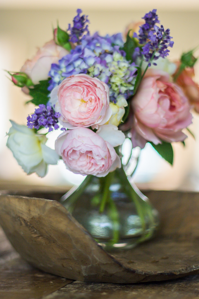 Cut flower arrangement of roses, hydrangea and lavender