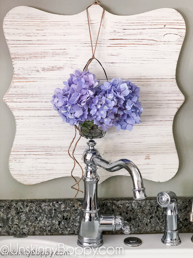Periwinkle Hydrangea hanging above chrome faucet sink