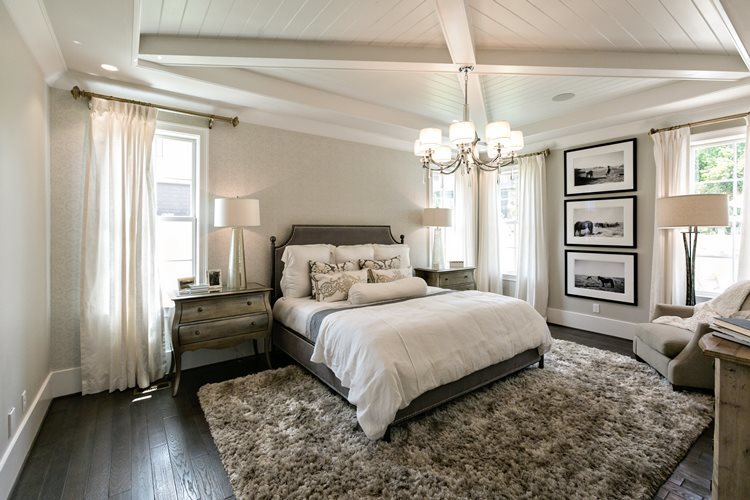 Bedroom with white shiplap ceiling and beams