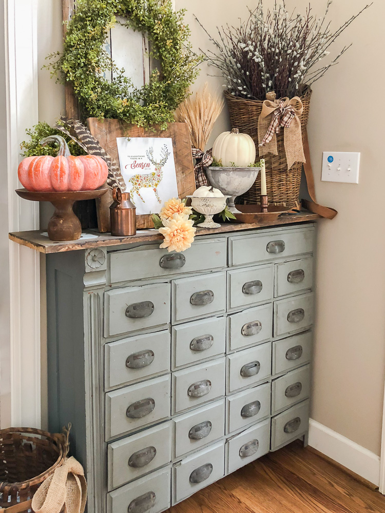apothecary cabinet decorated for fall-1