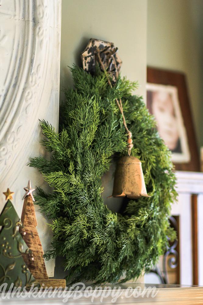 Brass bell in evergreen wreath