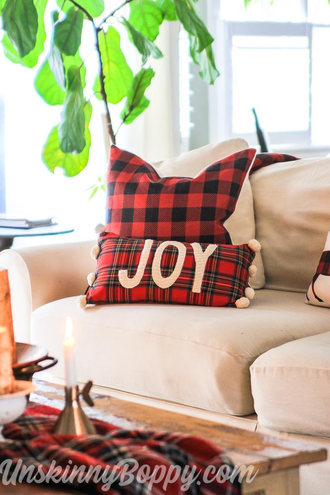 Joy pompom pillow from mud pie