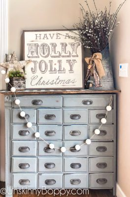 Vintage Christmas Decor apothecary cabinet