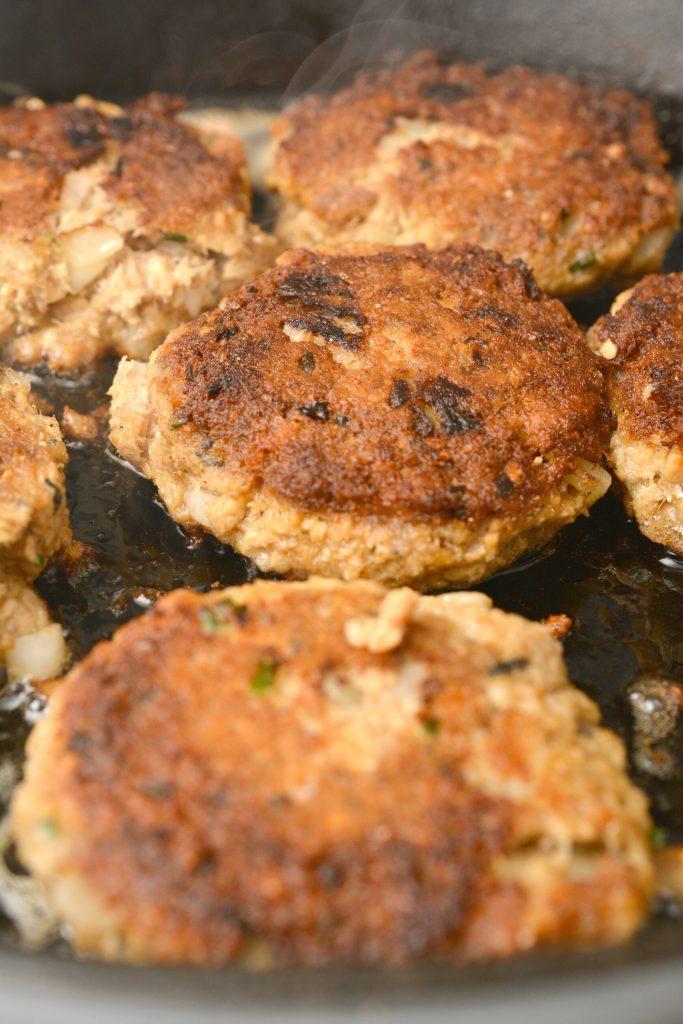 keto patties cooking in skillet