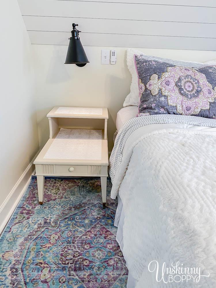 Dreamy loft bedroom makeover with Bohemian vibe, shiplap and aqua/purple rug