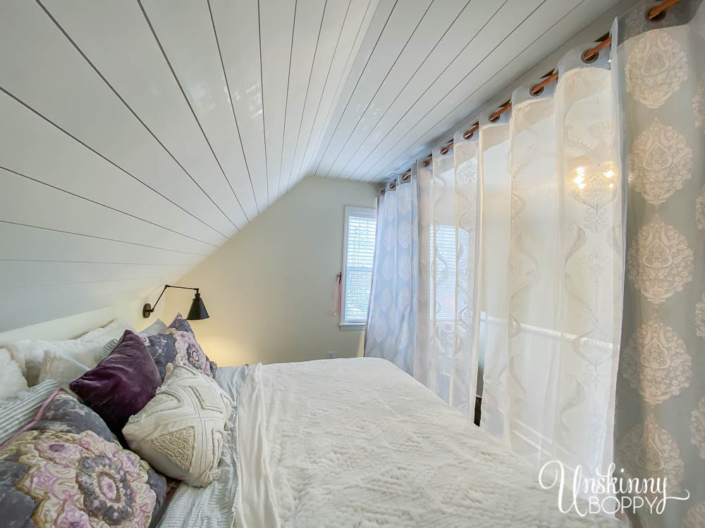 Dreamy loft bedroom makeover with Bohemian vibe, hand hewn beam and sheer curtains