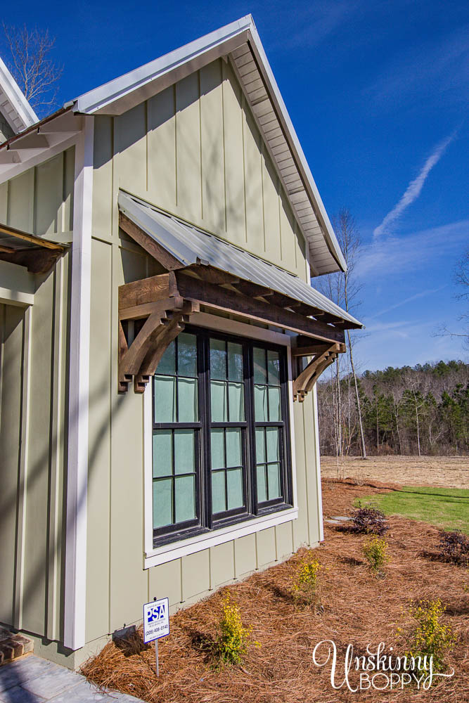 Metal shed roof with wood corbels and brackets, board and batten siding