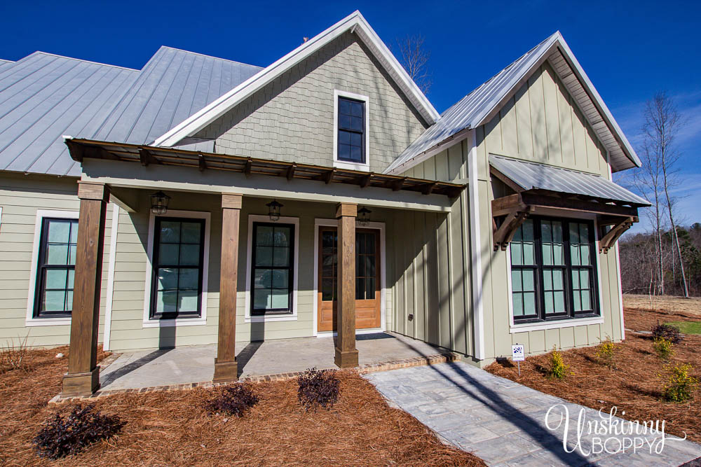 Front porch of modern farmhouse with tin roof