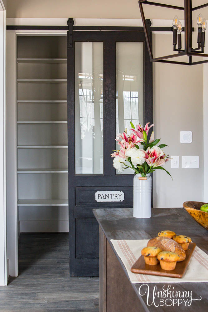 Custom barn door with glass inserts for pantry