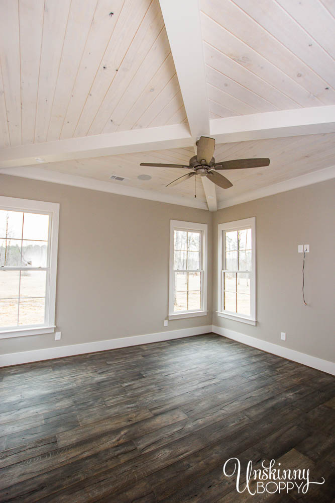 Master bedroom with X beam and whitewashed V-groove ceilings