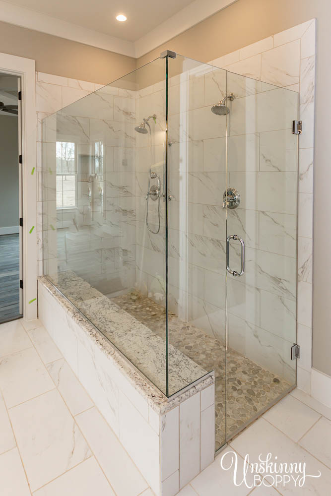Master Shower with two heads and built-in bench