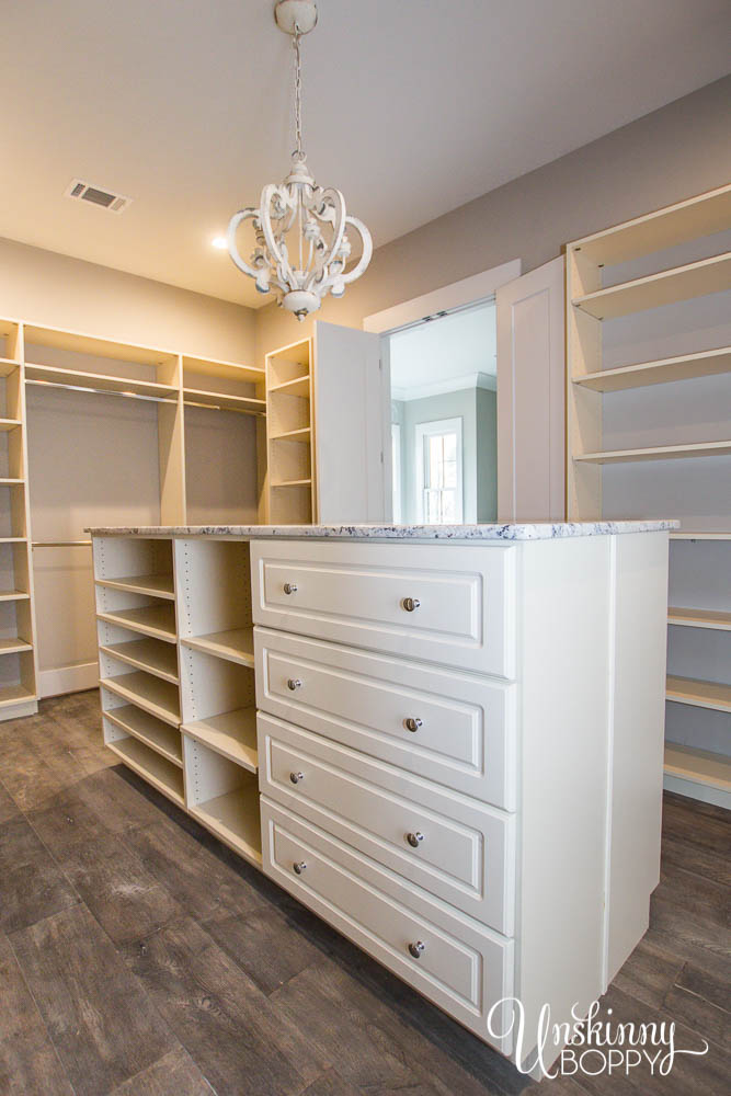 Huge Master closet with island storage