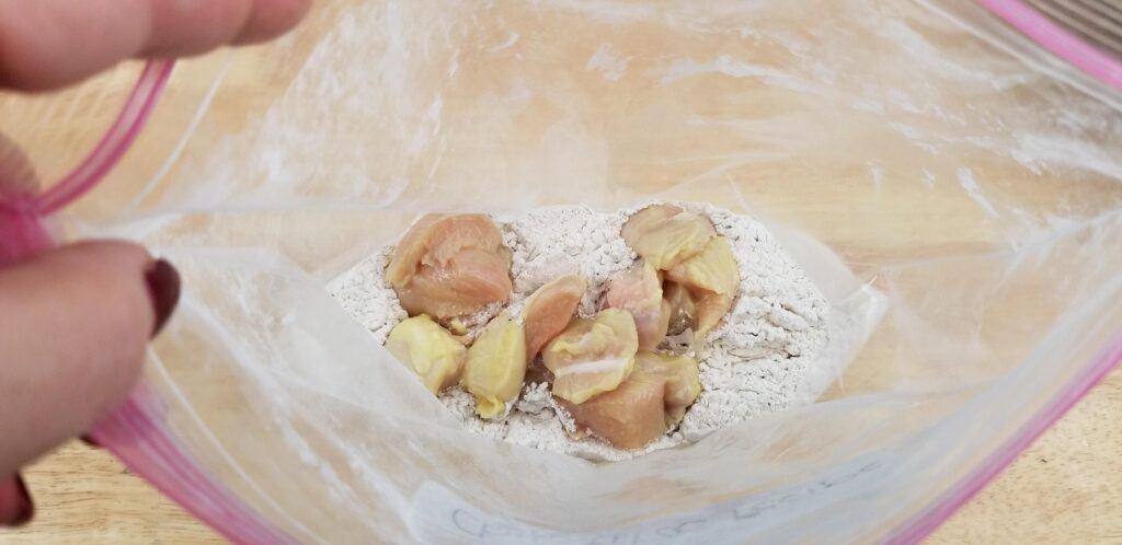 Coat chicken in flour, shake in ziploc bag