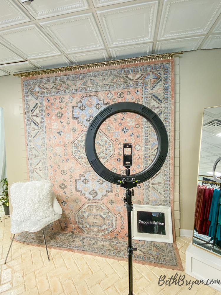 selfie station with rug on wall at tapp18